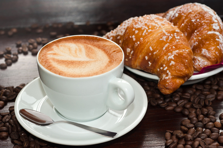 Photo for  cappuccino with Brioches and coffee beans - Royalty Free Image