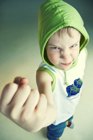 Angry little boy with fist