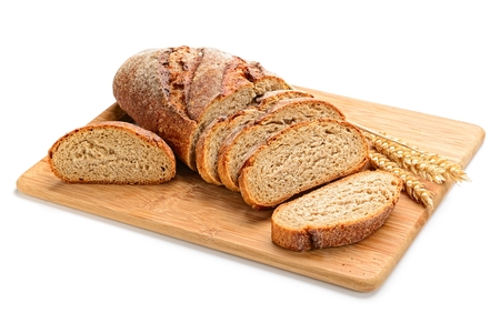 Photo for fresh sliced bread  and wheat on wooden board isolated on white - Royalty Free Image
