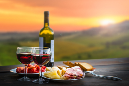 Photo pour still life Red wine  ,cheese and prosciutto. Romantic dinner  outdoors - image libre de droit