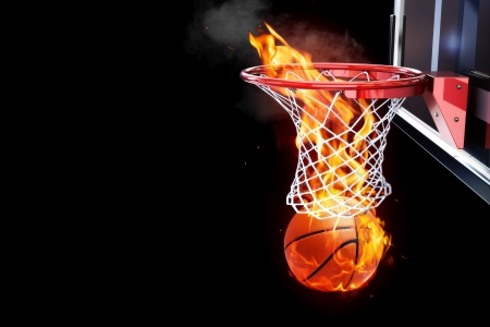 Flaming basketball going through a court net  Room for text or copy space on a black background