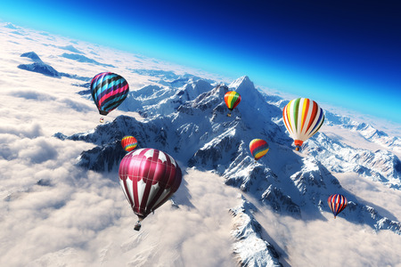 Photo for Colorful hot air balloon s soaring above a majestic snow caped mountain scape  - Royalty Free Image