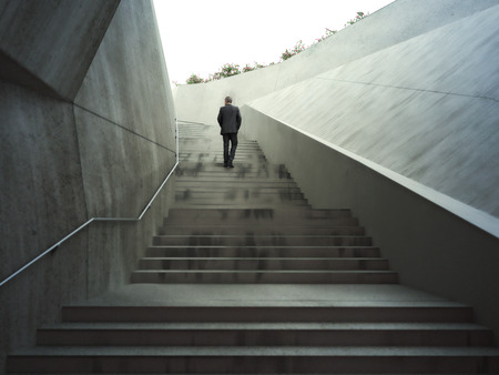 Photo pour Ambitions concept with a businessman climbing up abstract stairs .Photo realistic 3d rendering. - image libre de droit