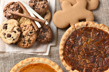 Photo for Assorted holiday desserts including:  gingerbread, pumpkin pie, pecan pie, chocolate chip and oatmeal raisin cookies, - Royalty Free Image