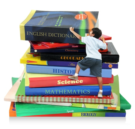 Photo for A boy climbing the books, as symbol of education step / milestone - Royalty Free Image