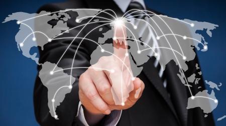 Business man touching world map screen  Social network