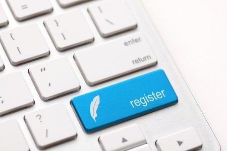 Foto de Closeup of register key in a modern keyboard  - Imagen libre de derechos