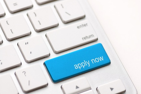Foto de Apply Now Computer Key In blue For Work Application - Imagen libre de derechos