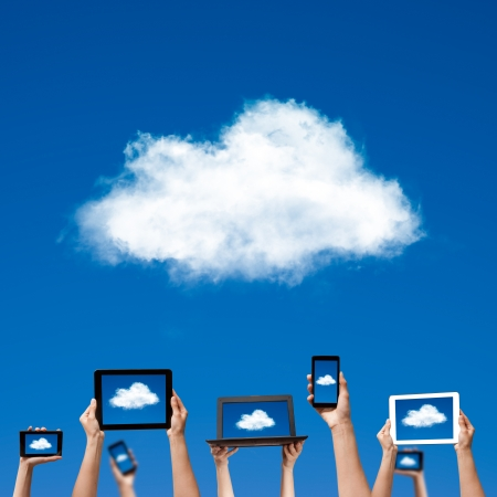 Foto de cloud computing concept  hands holding computer laptop smart phone tablet and touch pad  - Imagen libre de derechos