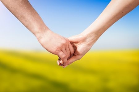 Photo for Close-up Holding Hands - Royalty Free Image
