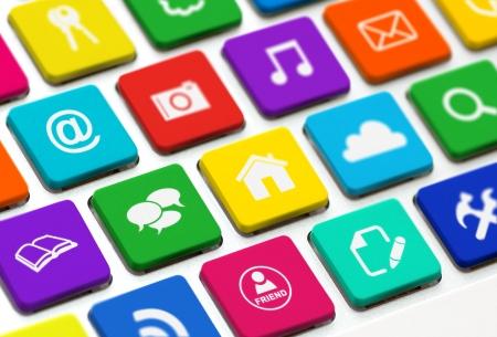 Foto de Modern keyboard with colored buttons and social media symbols - Imagen libre de derechos