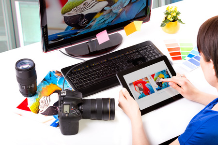 Foto de Photo editor working on computer and used graphics tablet  - Imagen libre de derechos