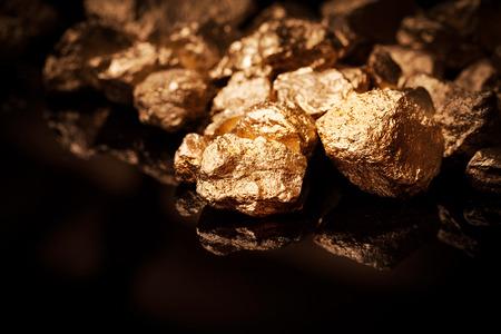 Foto de Gold nuggets isolated on black background  - Imagen libre de derechos