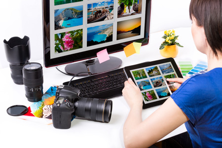 Photo for Photo editor working on computer and used graphics tablet  - Royalty Free Image
