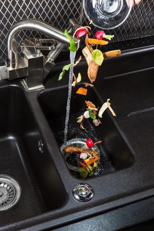 Foto de Disposer food waste machine for your kitchen. - Imagen libre de derechos