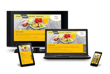 Foto de Responsive web design on mobile phone devices laptop and tablet pc - Imagen libre de derechos