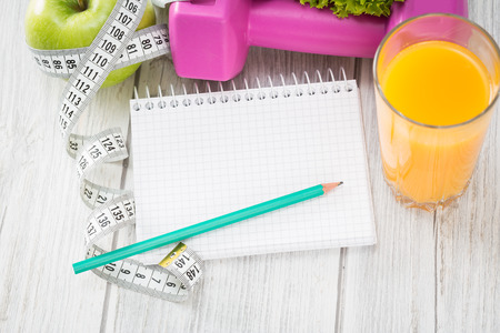 Photo for Workout and fitness dieting copy space diary on wooden table. - Royalty Free Image