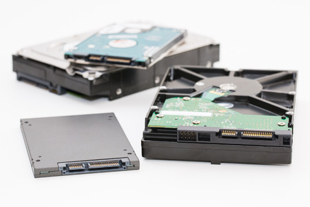 Foto de Hard disk next to ssd disk (solid state drive)i. Isolated on white background. - Imagen libre de derechos