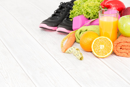Foto de Fitness equipment and healthy nutrition on wood background. - Imagen libre de derechos