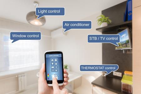 Foto de Remote home control system on a digital tablet or phone. - Imagen libre de derechos