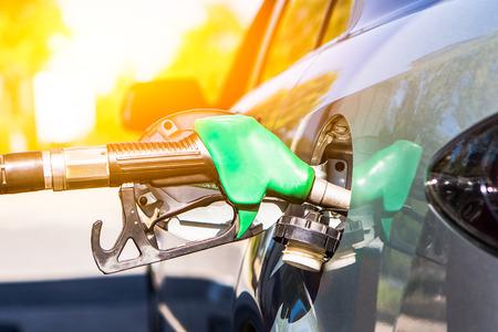 Photo pour Gun petrol in the tank to fill. Car refueling concept. - image libre de droit