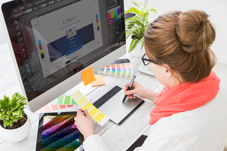 Foto de Graphic designer at work. Color swatch samples. - Imagen libre de derechos