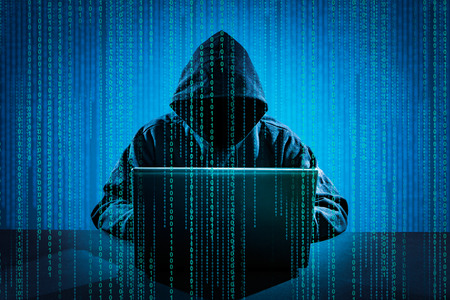 Foto de Hacker using laptop. Hacking the Internet. - Imagen libre de derechos