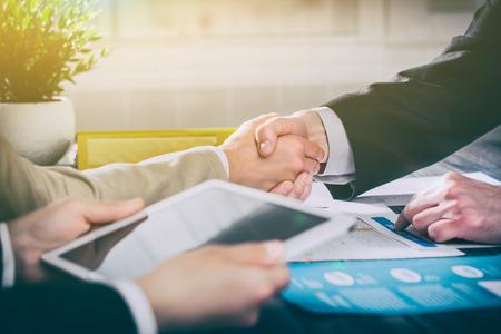 Foto de business hand shake people handshake meeting partnership work job -  stock image - Imagen libre de derechos