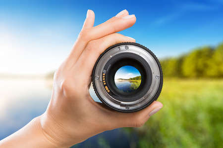 Photo pour photography view camera photographer lens lense through video photo digital glass hand blurred focus people concept - stock image - image libre de droit