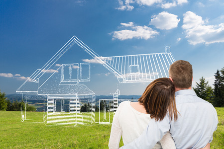 Foto de Loving young couple looking at dream house. - Imagen libre de derechos