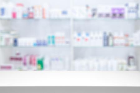 Foto de counter store table pharmacy background shelf blurred blur focus drug medical shop drugstore medication blank medicine pharmaceutics concept - stock image - Imagen libre de derechos