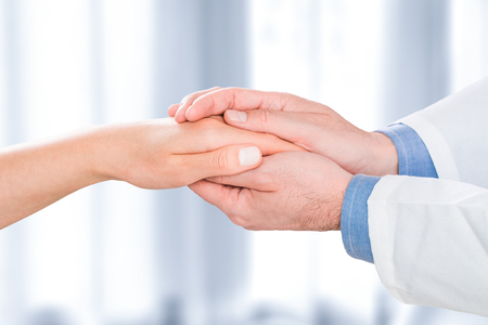 Foto de patient doctor trust hand compassion medical thanks medic male female woman visit practitioner sympathy human positive symbol cheerful comforting consulting employee hospital friendly - stock image - Imagen libre de derechos