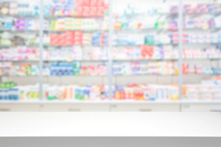 Photo for counter store table pharmacy background shelf blurred blur focus drug medical shop drugstore medication blank medicine pharmaceutics concept - stock image - Royalty Free Image