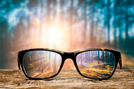 Foto de glasses focus background wooden eye vision lens eyeglasses nature reflection look looking through see clear sight concept transparent sunrise prescription sunset vintage sunny sun retro - stock image - Imagen libre de derechos