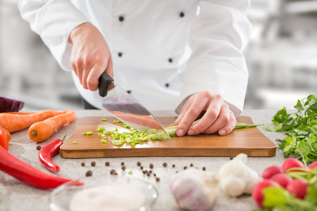 Foto de chef cooking food kitchen restaurant cutting cook hands hotel man male knife preparation fresh preparing concept - stock image - Imagen libre de derechos