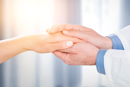 Foto de doctor patient care holding human hand trust touch medical thanks help clinic health concept - stock image - Imagen libre de derechos