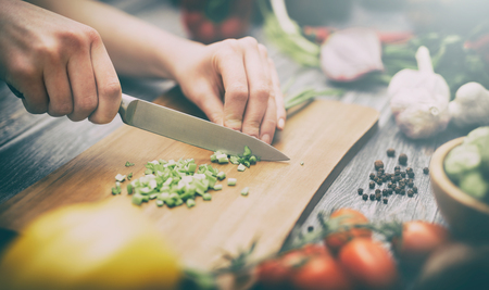 cooking healthy lifestyle meal prepare food women life dinner vegan kitchen live diet hands salad chef happy concept - stock image