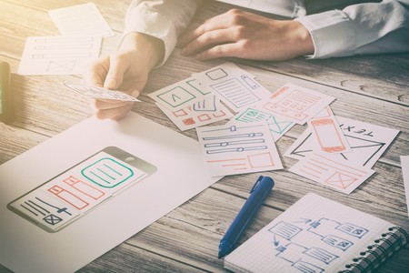 Foto de ux designer designing designers web brand phone smartphone layout geek business prototype internet goals sketch plan write idea success solution concept - stock image - Imagen libre de derechos