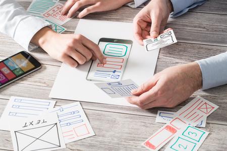 Photo for ux designer designing designers web brand phone smartphone layout geek business prototype internet goals sketch plan write idea success solution concept - stock image - Royalty Free Image
