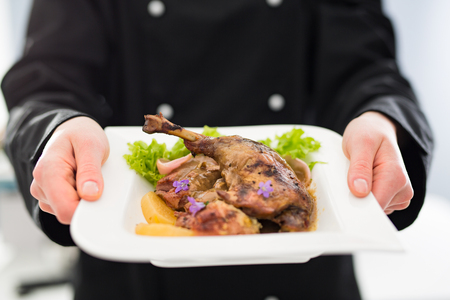 Foto de chef cooking restaurant food dish dine fine plate serve hotel garnish gourmet molecular prepare culinary holding decorating concept - stock image - Imagen libre de derechos