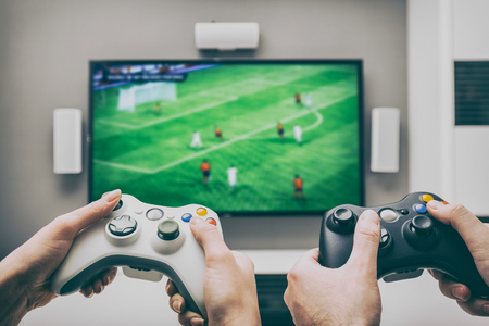 Foto de gaming game play tv fun gamer gamepad guy controller video console playing player holding hobby playful enjoyment view concept - stock image - Imagen libre de derechos