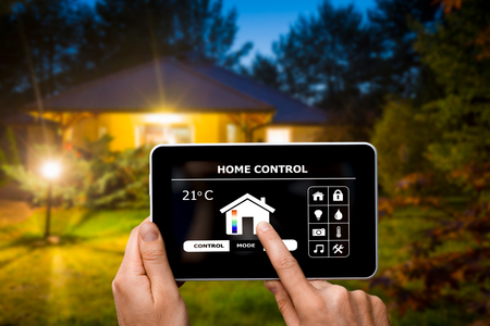 Photo pour Remote home control system on a digital tablet or phone. - image libre de droit