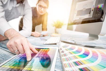 Foto de Graphic designer at work. Color swatch samples. - Imagen libre de derechos