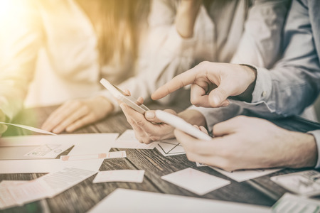 Photo for A group of people designers designing a wireframe application of mobile phone and responsive websites. Teamwork and user experience. - Royalty Free Image