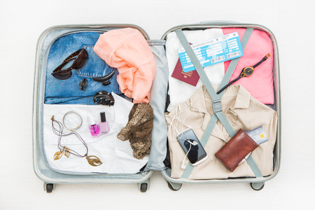 Foto de travel traveler traveling bag top open view packing card camera packed credit wallet clothing table leaving departure concept - stock image - Imagen libre de derechos