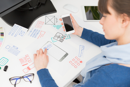 Foto de Designer woman drawing website ux app development. User experience concept. - Imagen libre de derechos