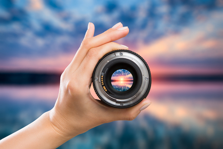 Photo pour photography view camera photographer lens lense through video photo digital glass hand blurred focus people sun sunset sunrise cloud sky water lake concept - stock image - image libre de droit