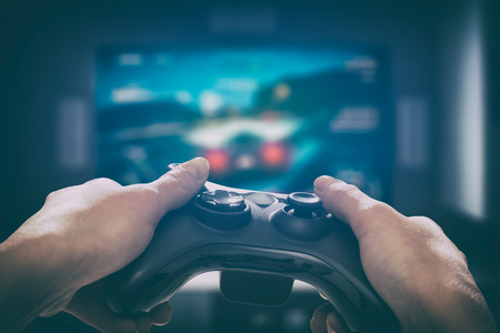 Foto de gaming game play tv fun gamer gamepad guy controller video console playing player holding hobby playful enjoyment view concept - stock image - Imagen libre de derechos