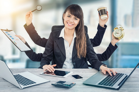 Foto de Multitask business woman with many hands. Performing several actions at the same time. - Imagen libre de derechos