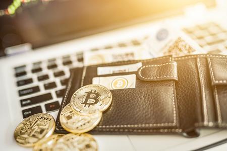 Foto de Virtual currency wallet. Bitcoin gold coin and printed encrypted money with QR code. Cryptocurrency concept. - Imagen libre de derechos